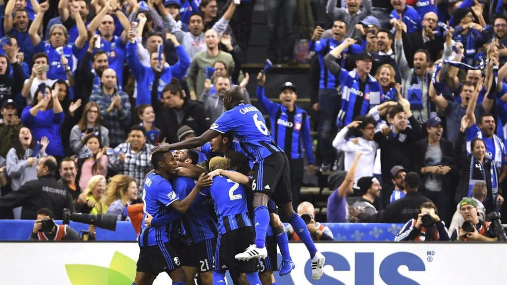 Montreal Impact players celebrate Matteo Mancosu's goal against Toronto FC during the first half of an MLS Eastern Conference final soccer match in Montreal, Tuesday, Nov.22, 2016. (Ryan Remiorz/The Canadian Press via AP)