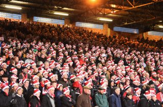 LONDON, ENGLAND - DECEMBER 26: Fans wear 'Father Christmas' style hats during the Barclays Premier League match between Crystal Palace and Southampton at Selhurst Park on December 26, 2014 in London, England. (Photo by Christopher Lee/Getty Images)