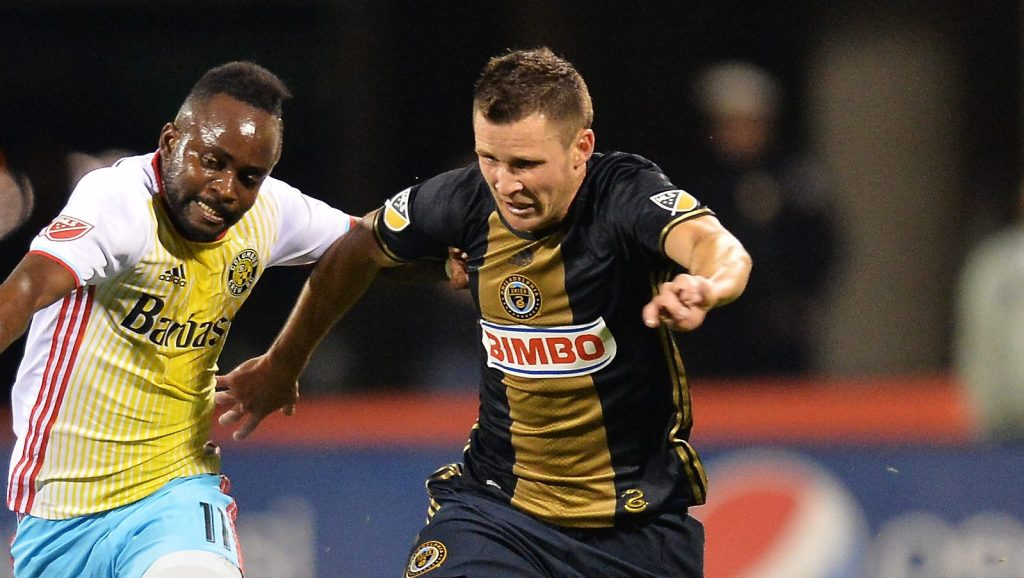 COLUMBUS, OH - MARCH 12: Cedrick Mabwati #11 of the Columbus Crew SC and Keegan Rosenberry #12 of the Philadelphia Union battle for position as they race to control the ball in the second half on March 12, 2016 at MAPFRE Stadium in Columbus, Ohio. Philadelphia defeated Columbus 2-1. (Photo by Jamie Sabau/Getty Images)