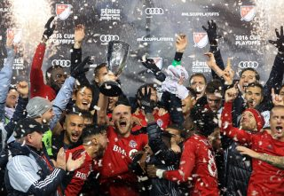 TORONTO, ON - NOVEMBER 30: Michael Bradley #4 of Toronto FC and teammates celebrate with the Eastern Conference Trophy following the MLS Eastern Conference Final, Leg 2 game against Montreal Impact at BMO Field on November 30, 2016 in Toronto, Ontario, Canada. (Photo by Vaughn Ridley/Getty Images)