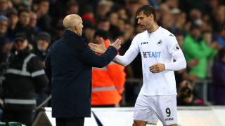 SWANSEA, WALES - DECEMBER 10: Bob Bradley, Manager of Swansea City (L) embraces Fernando Llorente of Swansea City (R) after he is subbed during the Premier League match between Swansea City and Sunderland at the Liberty Stadium on December 10, 2016 in Swansea, Wales. (Photo by Michael Steele/Getty Images)