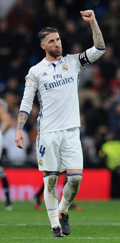 MADRID, SPAIN - DECEMBER 10: Sergio Ramos of Real Madrid celebrates after Real beat RC Deportivo La Coruna 3-2 in the La Liga match between Real Madrid CF and RC Deportivo La Coruna at Estadio Santiago Bernabeu on December 10, 2016 in Madrid, Spain. (Photo by Denis Doyle/Getty Images)