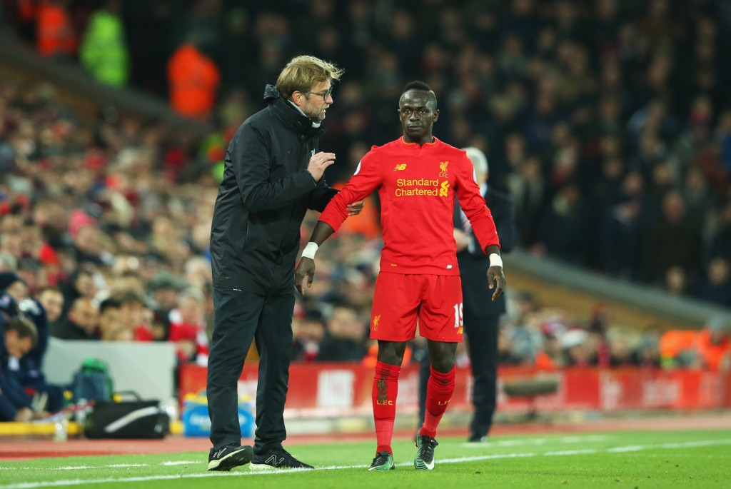 LIVERPOOL, ENGLAND - DECEMBER 27:  Jurgen Klopp manager of Liverpool gives instructions to Sadio Mane of Liverpool during the Premier League match between Liverpool and Stoke City at Anfield on December 27, 2016 in Liverpool, England.  (Photo by Alex Livesey/Getty Images)