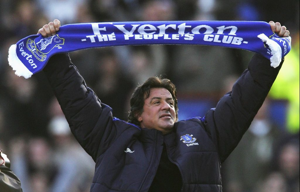 LIVERPOOL, UNITED KINGDOM - JANUARY 14: Hollywood Actor Sylvester Stallone salutes the fans with an Everton scarf prior to the start of the Barclays Premiership match between Everton and Reading at Goodison Park on January 14, 2007 in Liverpool, England. (Photo by Michael Steele/Getty Images)