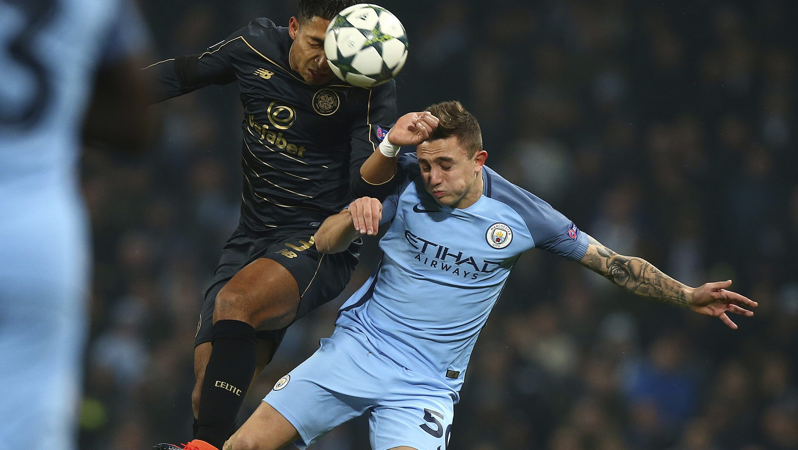 Celtic's Emilio Izaguirre, left, and City's Pablo Maffeo challenge for the ball during the Champions League group C soccer match between Manchester City and Celtic at the Etihad stadium in Manchester, England, Tuesday, Dec. 6, 2016.(AP Photo/Dave Thompson))