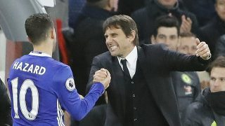 Chelsea's Eden Hazard, left, and Chelsea's team manager Antonio Conte celebrate after winning the English Premier League soccer match between Chelsea and Bournemouth at Stamford Bridge stadium in London, Monday, Dec. 26, 2016.(AP Photo/Frank Augstein)