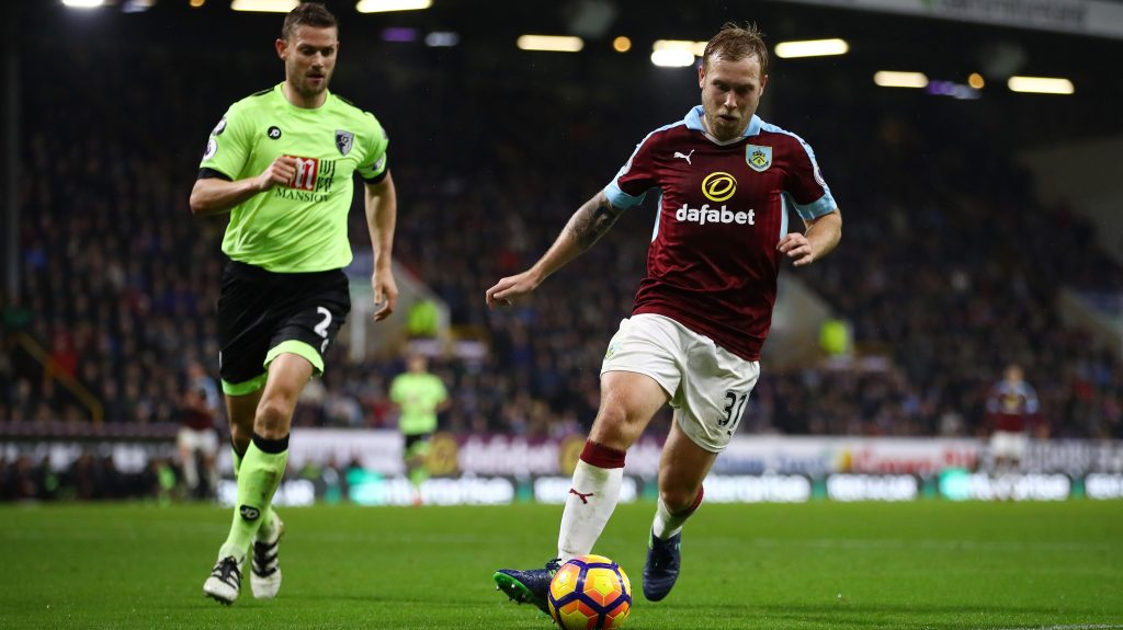 BURNLEY, ENGLAND - DECEMBER 10: Ashley Barnes of Burnley (R) is put under pressure from Simon Francis of AFC Bournemouth (L) during the Premier League match between Burnley and AFC Bournemouth at Turf Moor on December 10, 2016 in Burnley, England. (Photo by Clive Brunskill/Getty Images)