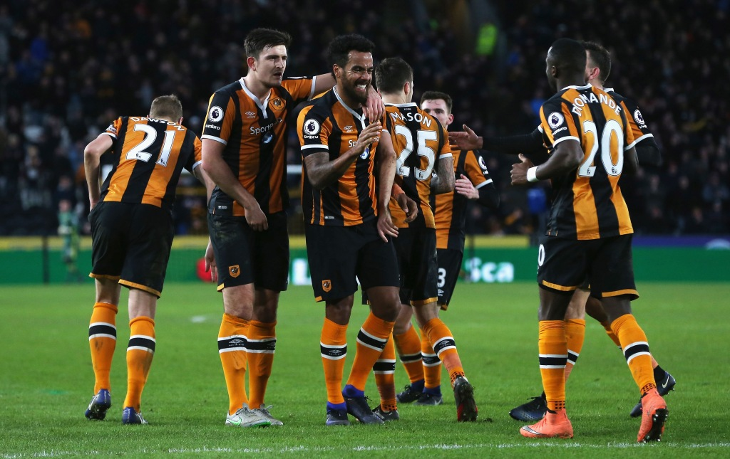 HULL, ENGLAND - JANUARY 14: Tom Huddlestone of Hull City (C) celebrates his side third goal with his Hull City team mates during the Premier League match between Hull City and AFC Bournemouth at KCOM Stadium on January 14, 2017 in Hull, England. (Photo by Nigel Roddis/Getty Images)