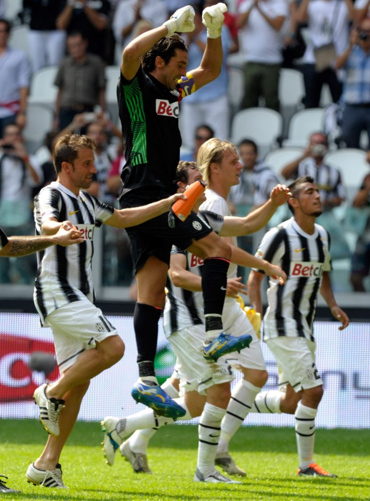 TURIN, ITALY - SEPTEMBER 11: (L-R) Mirko Vucinic, Alessandro Del Piero and Gianluigi Buffon of Juventus FC celebrate their victory after the Serie A match between Juventus FC v Parma FC at Juventus Stadium on September 11, 2011 in Turin, Italy. (Photo by Claudio Villa/Getty Images)