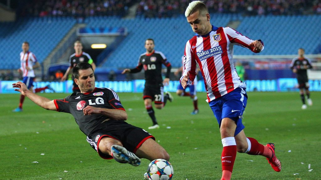 MADRID, SPAIN - MARCH 17: Antoine Griezmann of Atletico Madrid leaps over the challenge from Emir Spahic of Bayer Leverkusen during the UEFA Champions League round of 16 match between Club Atletico de Madrid and Bayer 04 Leverkusen at Vicente Calderon Stadium on March 17, 2015 in Madrid, Spain. (Photo by Gonzalo Arroyo Moreno/Getty Images)