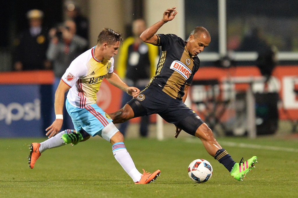 COLUMBUS, OH - MARCH 12: Ethan Finlay #13 of the Columbus Crew SC and Fabinho #33 of the Philadelphia Union battle for control of the ball in the first half on March 12, 2016 at MAPFRE Stadium in Columbus, Ohio. (Photo by Jamie Sabau/Getty Images)