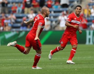 BRIDGEVIEW, IL - AUGUST 14: John Goossens #7 of Chicago Fire celebrates a goal against Orlando City FC with teammate Brandon Vincent #3 during an MLS match at Toyota Park on August 14, 2016 in Bridgeview, Illinois. The Fire and Orlando City SC tied 2-2. (Photo by Jonathan Daniel/Getty Images)