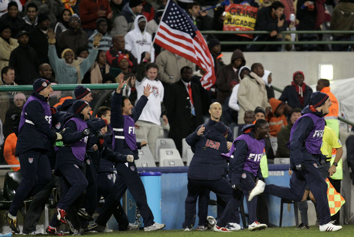Bob Bradley is at the center of celebrations after the U.S. shocked Spain in the 2009 Confederations Cup in South Africa. (AP)