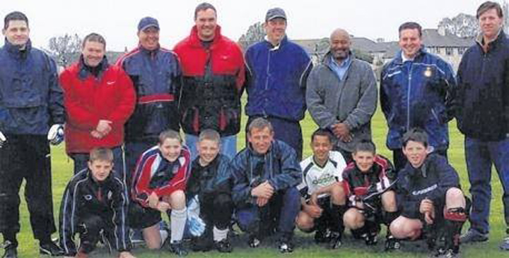 Lallana at age 11, with a number of other promising young Southampton-area players. Adam is kneeling on the far left in the bottom row; the third player from the right in the bottom row is Arsenal star Theo Walcott. (NBCSports.com)