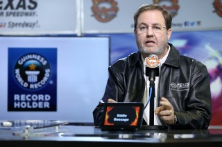 "FORT WORTH, TX - APRIL 06: Texas Motor Speedway President Eddie Gossage speaks during a press conference with Guinness World Records certifying the ""Big Hoss TV"" as the world's largest high-definition LED video board at Texas Motor Speedway on April 6, 2014 in Fort Worth, Texas. (Photo by Jeff Gross/Getty Images for Texas Motor Speedway)"