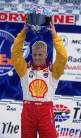 29 Apr 2001: Kenny Brack of Sweden who drives a Ford Lola for Shell Team Rahal hold up his helmet to show his pole position starting place for the Firestone Firehawk 600, part of the CART FedEx Championship series at the Texas Motor Speedway in Fort Worth, Texas.Mandatory Credit: Robert Laberge /Allsport