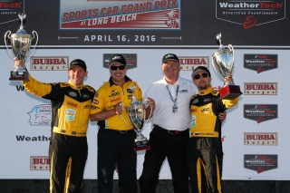 Simpson (far left) played spotter for Hildebrand in Indy. Photo courtesy of IMSA