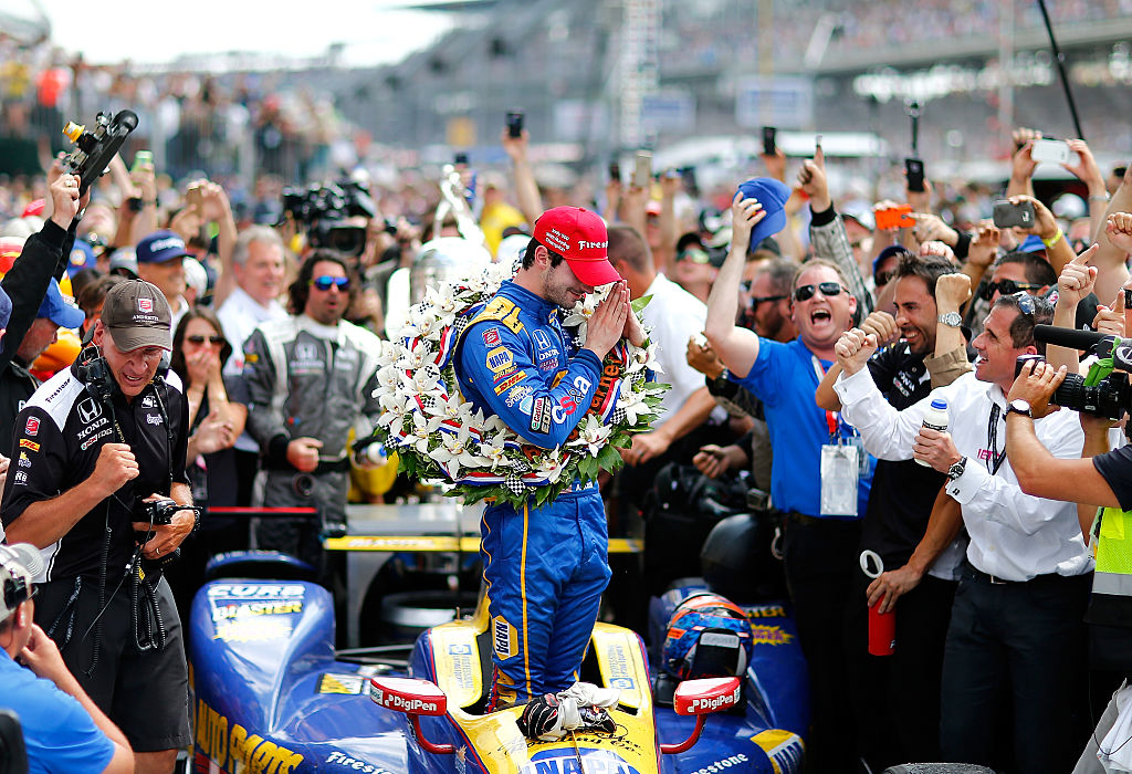 INDIANAPOLIS, IN - MAY 29: Alexander Rossi, driver of the #98 Andretti Herta Autosport Napa Dallara Honda celebrates in victory circle after winning the 100th Running of the Indianapolis 500 Mile Race at Indianapolis Motorspeedway on May 29, 2016 in Indianapolis, Indiana. (Photo by Jonathan Ferrey/Getty Images)
