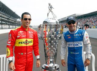 INDIANAPOLIS, IN - MAY 27: Helio Castroneves and Tony Kanaan of Brazil pose on the finish line with the Borg-Warner trophy during Carb Day ahead of the 100th running of the Indianapolis 500 at Indianapolis Motorspeedway on May 27, 2016 in Indianapolis, Indiana. (Photo by Jamie Squire/Getty Images)
