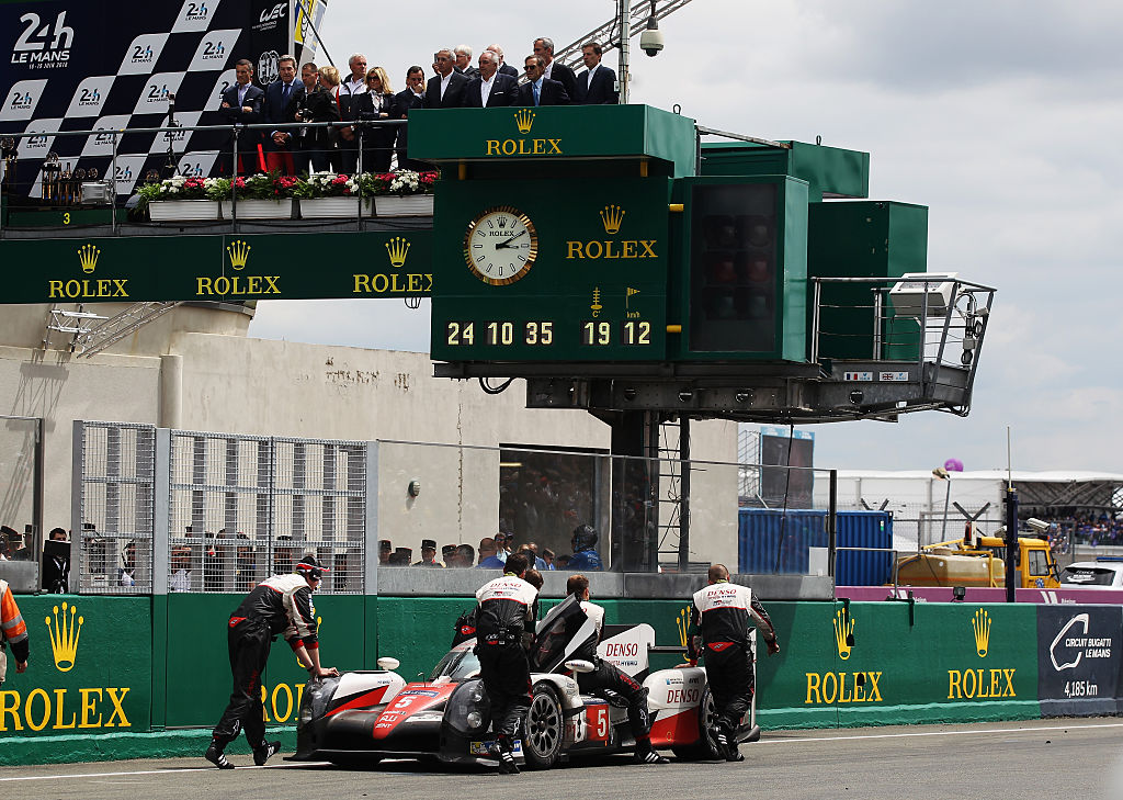 LE MANS, FRANCE - JUNE 19: The Toyota Gazoo Racing is pushed back to parc ferme after suffering engine problems at the end of the Le Mans 24 Hour race handing victory to the Porsche Team at the Circuit de la Sarthe on June 19, 2016 in Le Mans, France. (Photo by Ker Robertson/Getty Images)