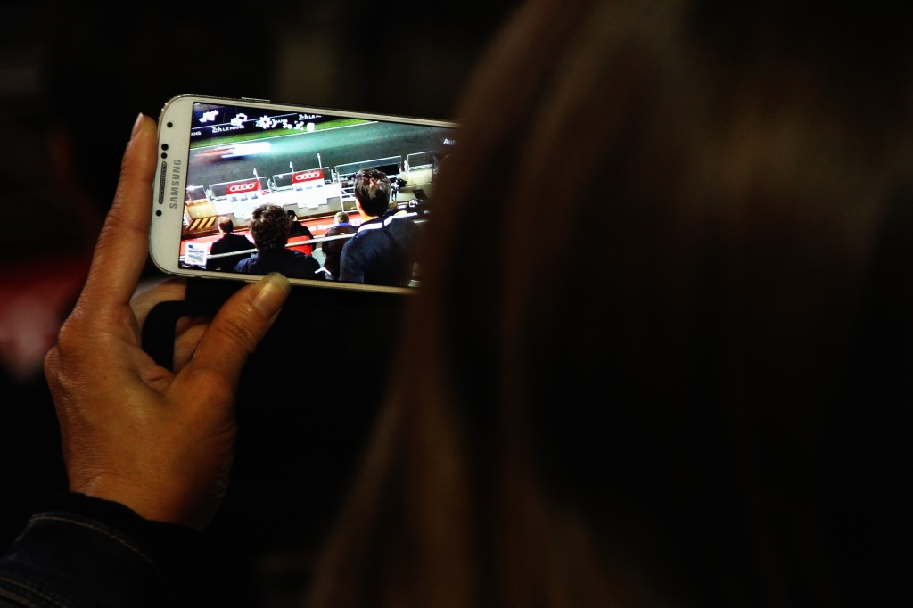 LE MANS, FRANCE - JUNE 15: Fan takes a picture on her camera phone during practice for the Le Mans 24 Hour race at the Circuit de la Sarthe on June 15, 2016 in Le Mans, France. (Photo by Ker Robertson/Getty Images)