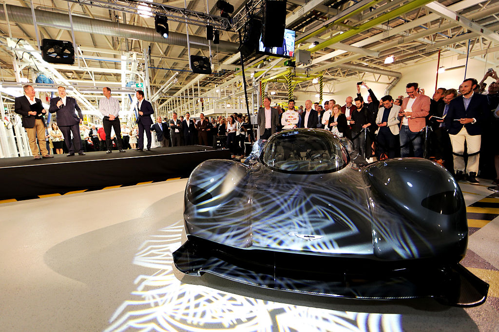 GAYDON, ENGLAND - JULY 05: Andy Palmer- President & Chief Executive Officer, Aston Martin Lagonda Ltd talks on stage at the Aston Martin and Red Bull Racing Project AMRB 001 Unveil on July 5, 2016 at the Aston Martin Headquarters in Gaydon, England on July 5, 2016 in Gaydon, England. (Photo by Mark Thompson/Getty Images)