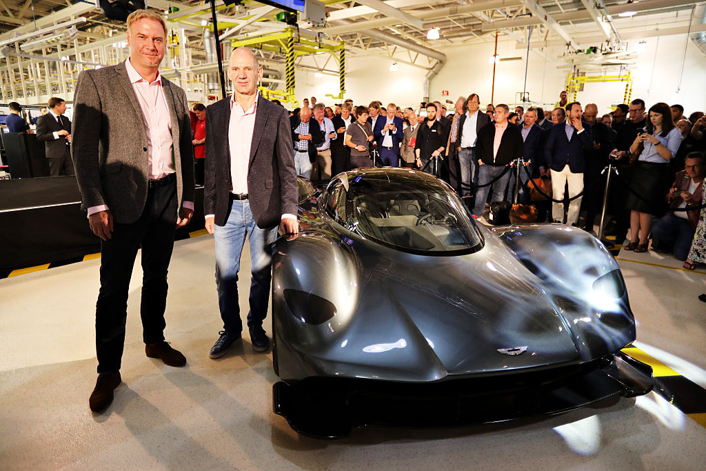 GAYDON, ENGLAND - JULY 05: Marek Reichman- Executive Vice President & Chief Creative Officer, Aston Martin Lagonda Ltd and Adrian Newey, the Chief Technical Officer of Red Bull Racing stand next to the AM-RB 001 at the Aston Martin and Red Bull Racing Project AMRB 001 Unveil on July 5, 2016 at the Aston Martin Headquarters in Gaydon, England on July 5, 2016 in Gaydon, England. (Photo by Mark Thompson/Getty Images)