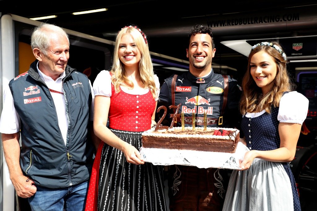 SPIELBERG, AUSTRIA - JULY 01: Daniel Ricciardo of Australia and Red Bull Racing celebrates his 27th birthday with a cake, Red Bull Racing Team Consultant Dr Helmut Marko and a couple of girls dressed in traditional Austrian dirndl dresses before practice for the Formula One Grand Prix of Austria at Red Bull Ring on July 1, 2016 in Spielberg, Austria. (Photo by Mark Thompson/Getty Images)