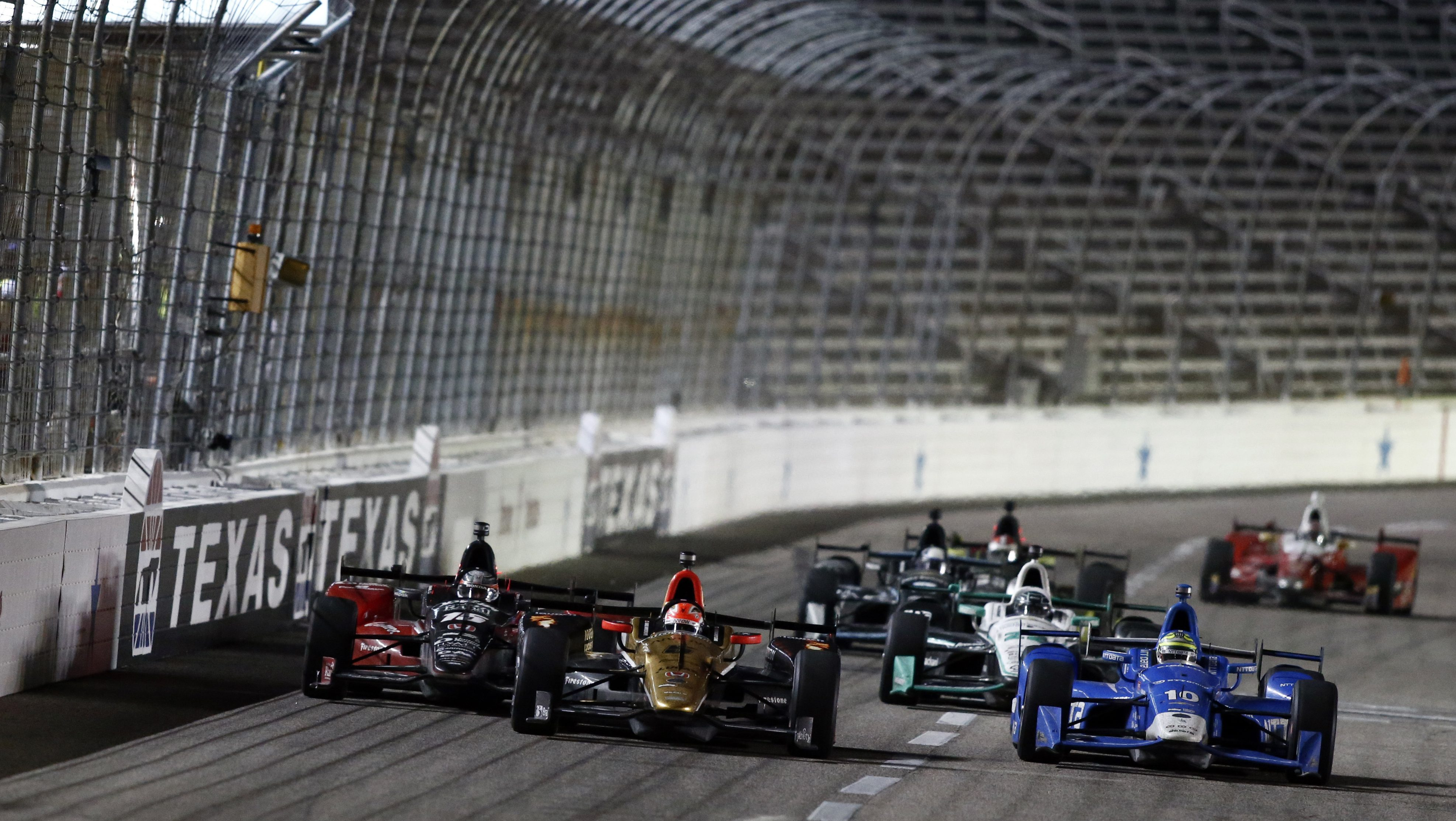 FORT WORTH, TX - AUGUST 27: James Hinchcliffe driver of the #5 Arrow Schmidt Peterson Motorsports Honda leads Tony Kanaan driver of the #10 NTT Data Chevrolet and Graham Rahal driver of the #15 Mi-Jack/RLL Honda going into the final lap during the Verizon IndyCar Series Firestone 600 at Texas Motor Speedway on August 27, 2016 in Fort Worth, Texas. (Photo by Mike Stone/Getty Images for Texas Motor Speedway)