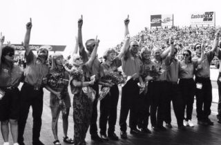 The friends and family of Blaine Johnson salute his memory in a touching starting-line ceremony prior to the start of the final eliminations of the 1996 U.S. Nationals in suburban Indianapolis.