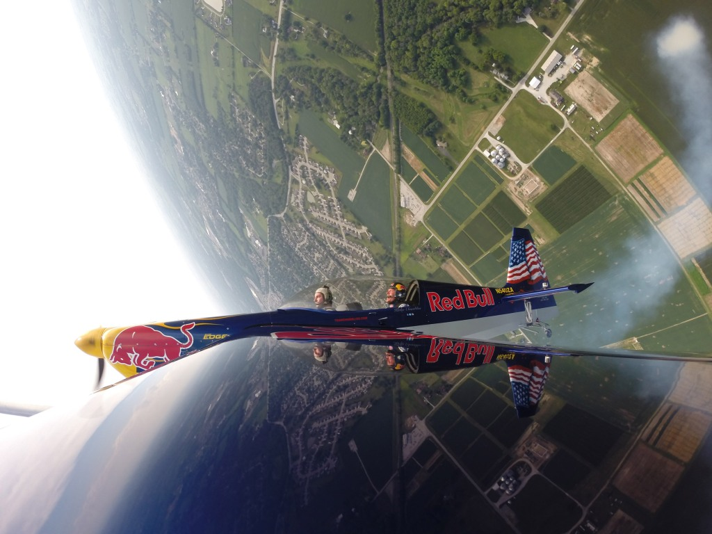 Indycar driver Alexander Rossi rides in Red Bull Air Race Pilot Kirby Chambliss' plane in Indianapolis, Indiana, USA on 01 August 2016.