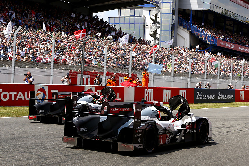 LE MANS, FRANCE - JUNE 15: Winners of the Le Mans 24 Hour 2014, Audi Sport Team Joest, Audi R18 E-Tron Quattro of Marcel Fassler, André Lotterer and Benoit Treluyer cross the line with 2nd place , Audi Sport Team Joest, Audi R18 E-Tron Quattro of Lucas Di Grassi, Loic Duval, Tom Kristensen on June 15, 2014 in Le Mans, France. (Photo by Andrew Hone/Getty Images)