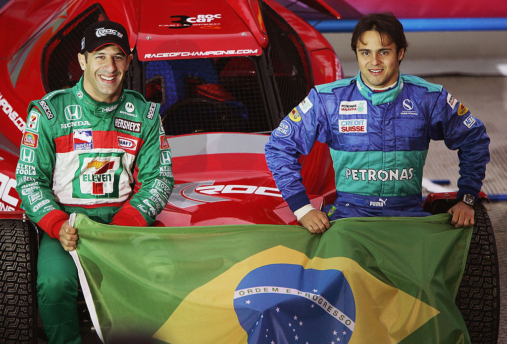 PARIS, FRANCE - DECEMBER 4:  Tony Kanaan and Felipe Massa of Brazil pose for photographers prior to the Race of Champions at the Stade de France on December 4, 2004 in Paris, France.  (Photo by Bryn Lennon Getty Images)