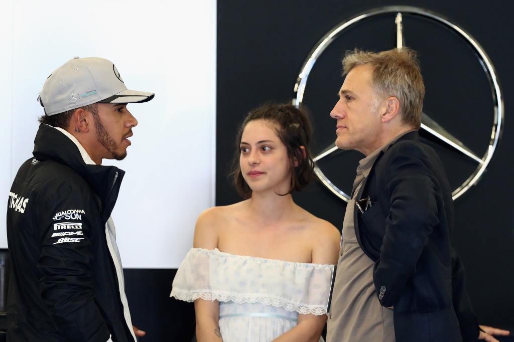 AUSTIN, TX - OCTOBER 22: Lewis Hamilton of Great Britain and Mercedes GP talks with actors Christoph Waltz and Rosa Salazar in the garage during final practice for the United States Formula One Grand Prix at Circuit of The Americas on October 22, 2016 in Austin, United States. (Photo by Lars Baron/Getty Images)