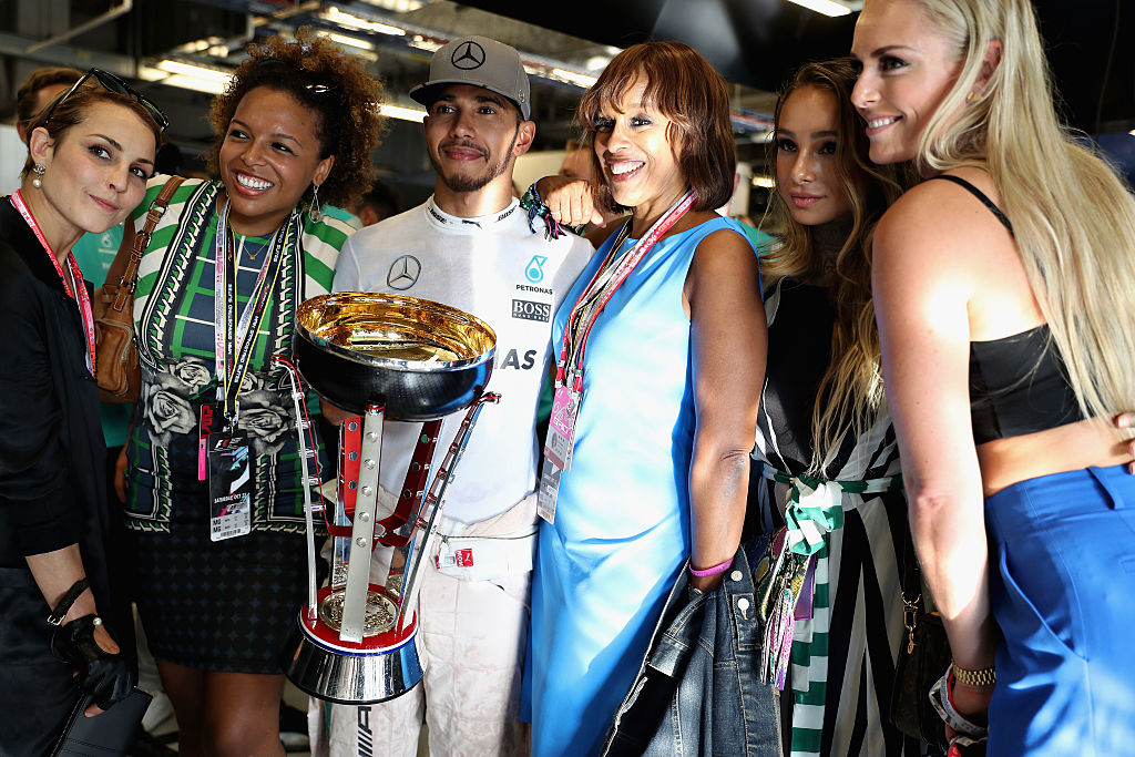 AUSTIN, TX - OCTOBER 23: Lewis Hamilton (C) of Great Britain and Mercedes GP celebrates with Kirby Bumpus (2nd-L), Gayle King (2nd-R) and Lindsey Vonn (R) during the United States Formula One Grand Prix at Circuit of The Americas on October 23, 2016 in Austin, United States. (Photo by Mark Thompson/Getty Images)