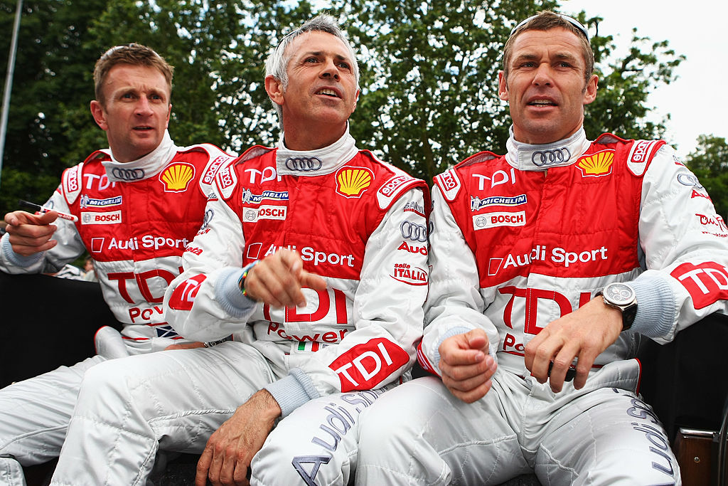 LE MANS, FRANCE - JUNE 13: (L-R) Allan McNish of Great Britain, Rinaldo Capello of Italy and seven time race winner Tom Kristensen of Denmark and Audi Sport North America attend the drivers parade in Le Mans town centre prior to the 76th running of the Le Mans 24 Hour race at the Circuit des 24 Heures du Mans on June 13, 2008 in Le Mans, France. (Photo by Mike Hewitt/Getty Images)