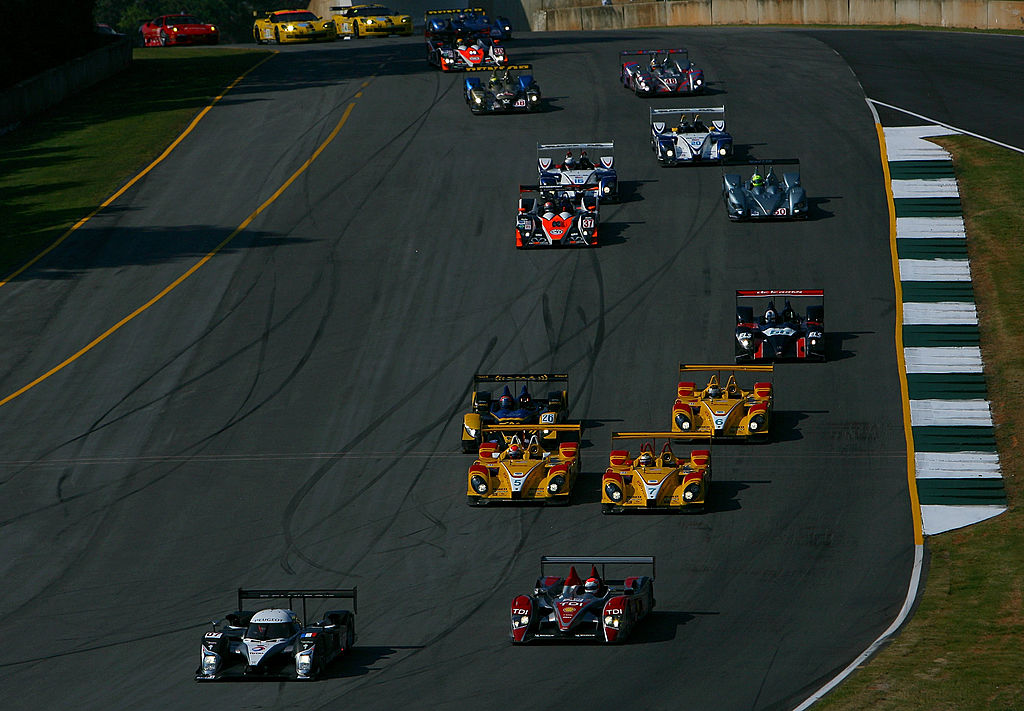 BRASELTON, GA - OCTOBER 04: The #07 LMP1 Peugeot Sport Total 908 driven by Nicolas Minassian leads Marco Werner in the #2 Audi Sport North America Audi R10 TDI as the field follows at the start of the American Le Mans Series Petit Le Mans on October 4, 2008 at Road Atlanta in Braselton, Georgia (Photo by Darrell Ingham/Getty Images)
