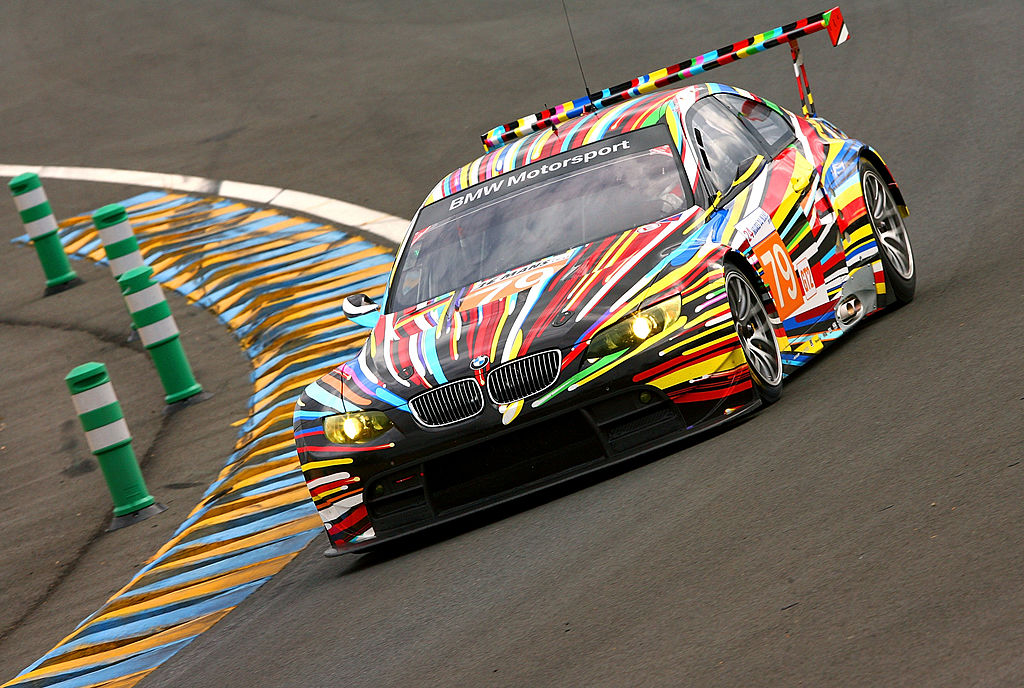 LE MANS, SARTHE - JUNE 09: Andy Priaulx of Great Britain drives the #79 BMW Motorsport BMW M3 which was painted by artist Jeff Koons during practice for the 78th running of the Le Mans 24 hours race at the Circuits des 24 Heures du Mans on 9 June 2010 in Le Mans, France. (Photo by Darrell Ingham/Getty Images)