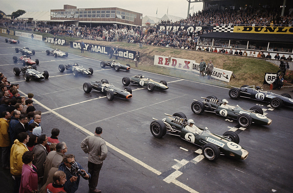 Jack Brabham of Australia driving the #5 Brabham Racing Organisation Brabham BT19 Repco 3.0 V8 lines up in pole position alongside team mate Denny Hulme in the #6 Brabham BT20 and Dan Gurney of the United States in the #16 Anglon American Racers Eagle T1G Climax 2.0 V8 before the start of the British Grand Prix on 16th July 1966 at the Brands Hatch circuit in Fawkham, Great Britain. (Photo by Don Morley/Getty Images)