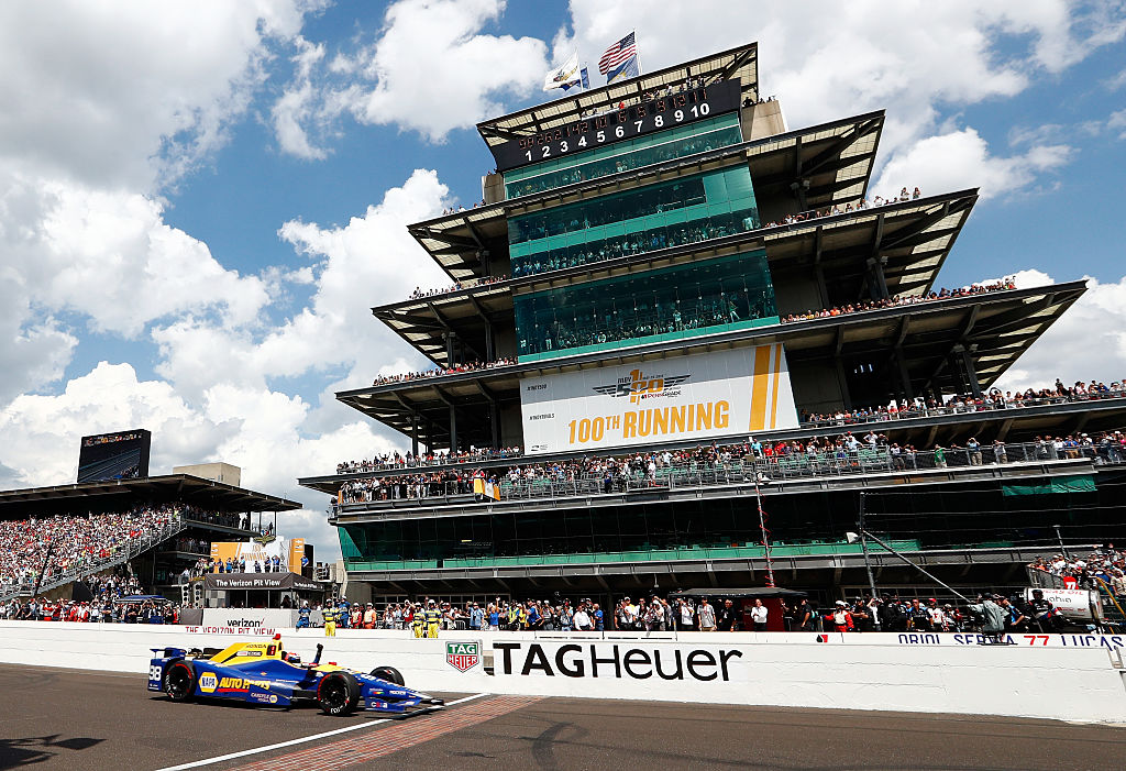 INDIANAPOLIS, IN - MAY 29:  Alexander Rossi of the United States pumps his fist as he crosses the finish line to win the 100th running of the Indianapolis 500 at Indianapolis Motorspeedway on May 29, 2016 in Indianapolis, Indiana.  (Photo by Jamie Squire/Getty Images)
