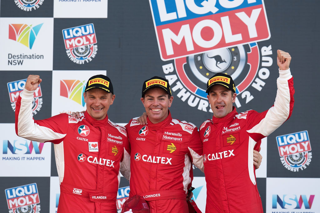 BATHURST, NEW SOUTH WALES - FEBRUARY 05: Toni Vilander, Craig Lowndes and Jamie Whincup drivers of the #88 Maranello Motorsport Ferrari celebrate on the podium after winning the 2017 Bathurst 12 hour race at Mount Panorama on February 5, 2017 in Bathurst, Australia. (Photo by Daniel Kalisz/Getty Images)