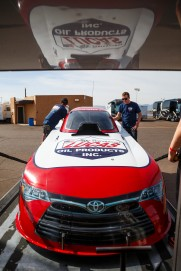 Del Worsham unloads his Funny Car Thursday in Phoenix.