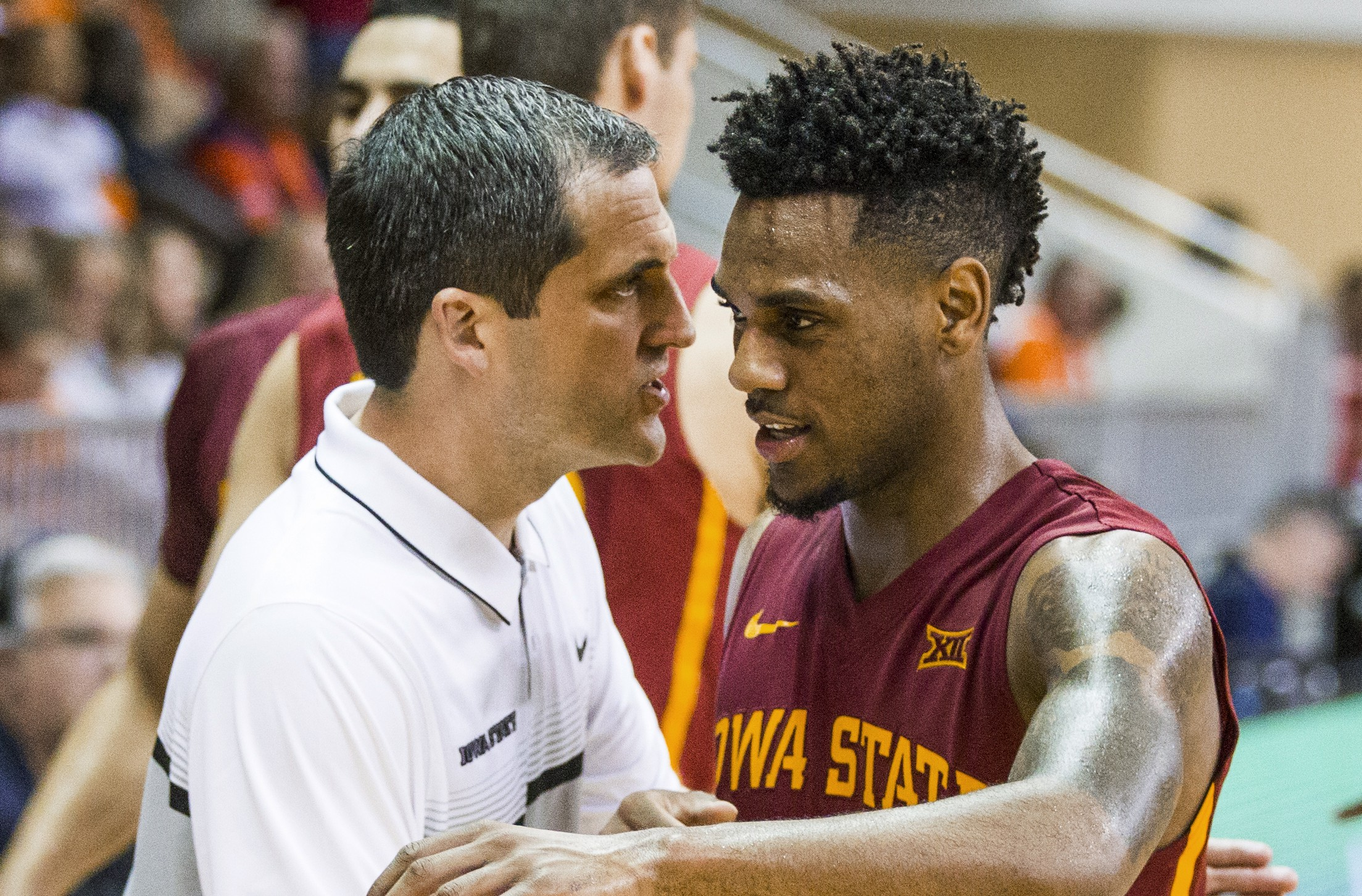 Steve Prohm and Monte Morris (AP Photo/Mark Wallheiser)