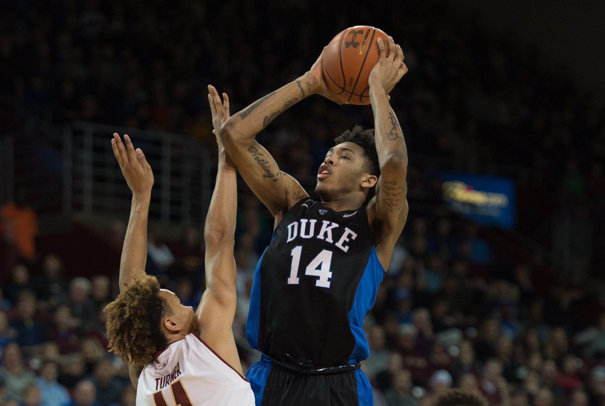 Duke guard Brandon Ingram (14) shoots the ball over the reach of Boston College forward A.J. Turner (11) during the second half of an NCAA college basketball game Saturday, Jan. 2, 2016, in Boston. Duke beat Boston College 81-64. (AP Photo/Gretchen Ertl)