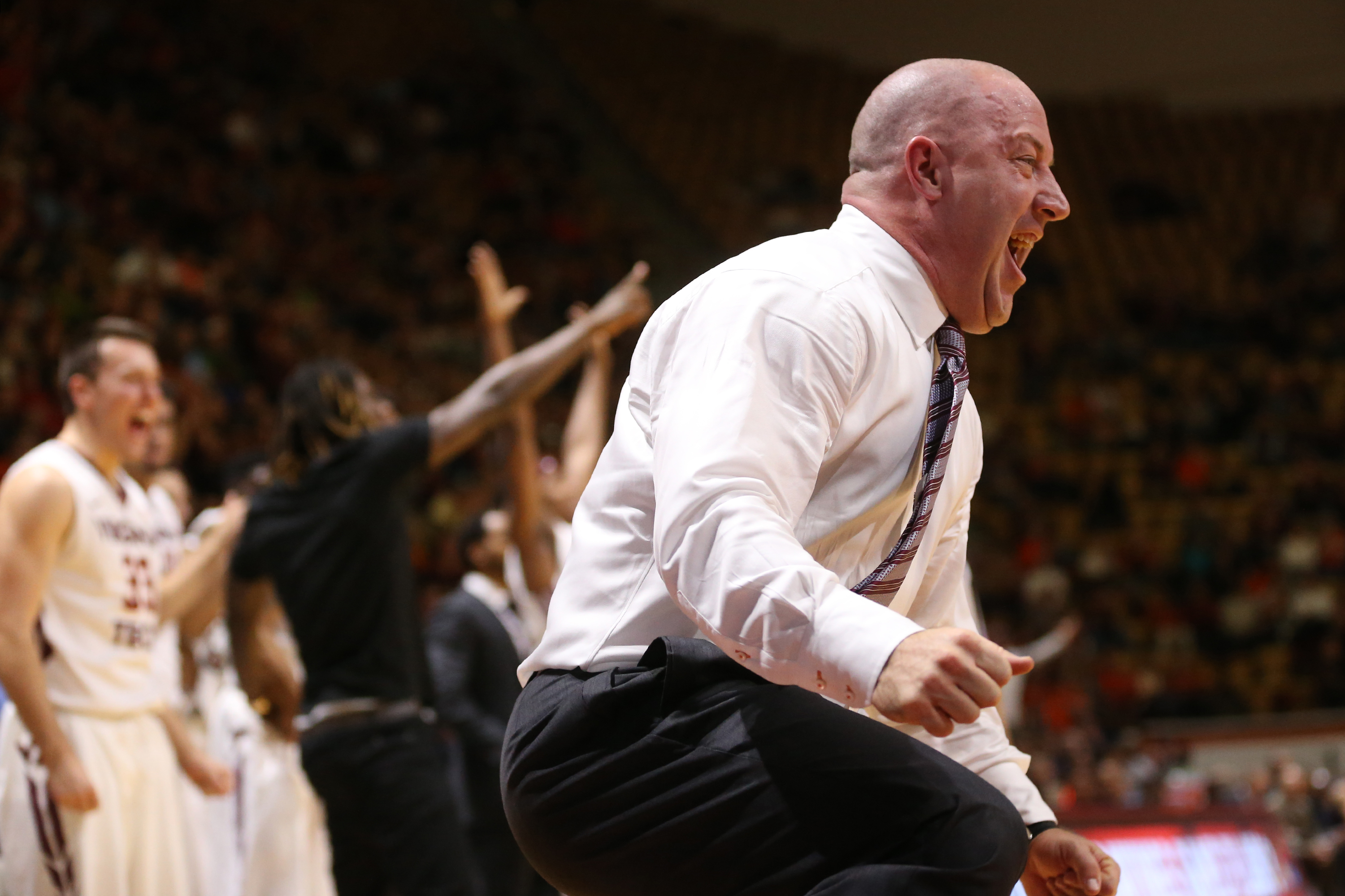 Virginia Tech head coach Buzz Williams celebrates a play in the first half of an NCAA college basketball game against Virginia, Monday, Jan. 4, 2016, in Blacksburg, Va. (Matt Gentry/The Roanoke Times via AP) LOCAL STATIONS OUT; LOCAL INTERNET OUT; LOCAL PRINT OUT (SALEM TIMES REGISTER; FINCASTLE HERALD; CHRISTIANSBURG NEWS MESSENGER; RADFORD NEWS JOURNAL; ROANOKE STAR SENTINEL; MANDATORY CREDIT