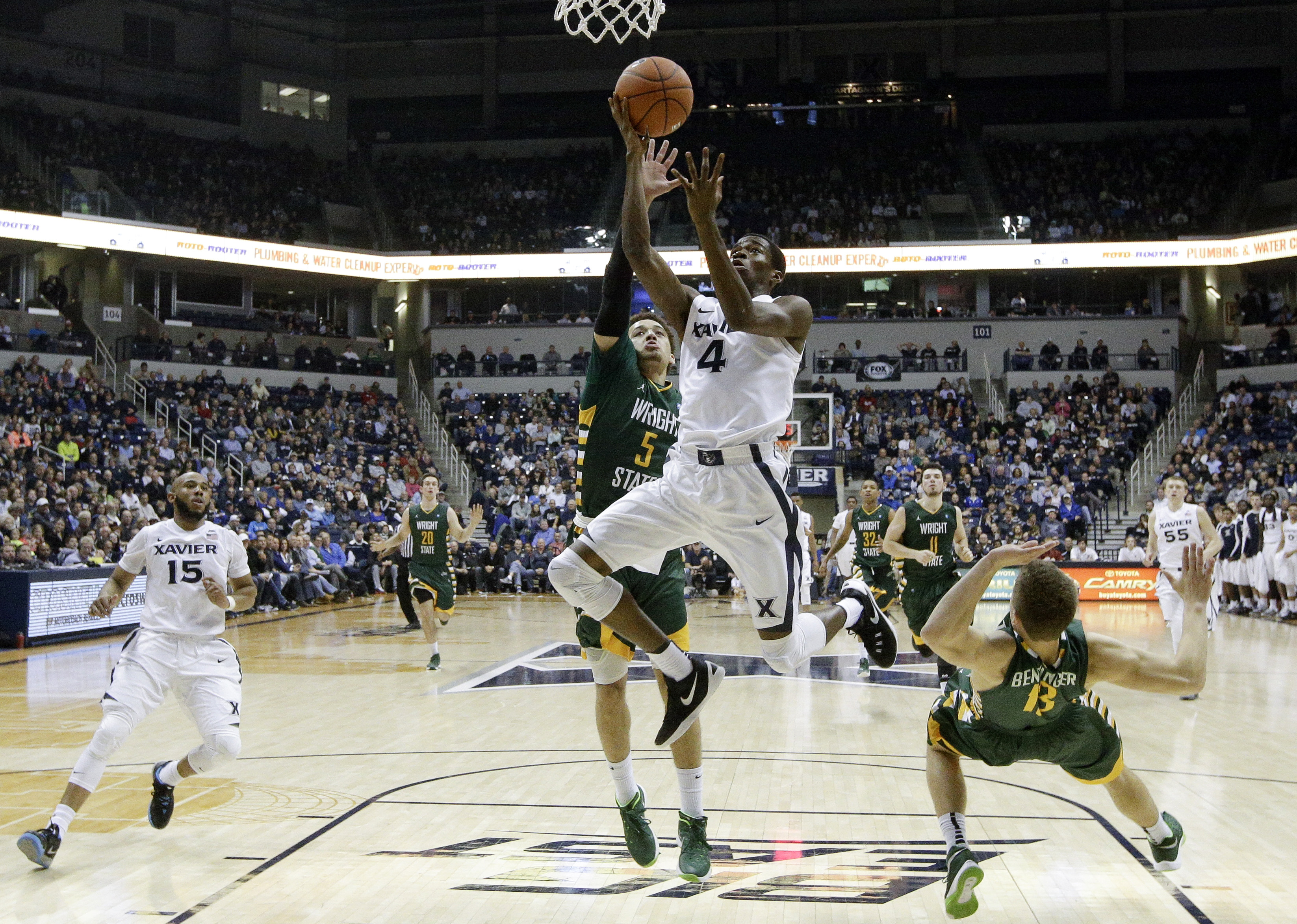 Xavier's Edmond Sumner (4) shoots over Wright State's Justin Mitchell (5) in the first half of an NCAA college basketball game, Tuesday, Dec. 8, 2015, in Cincinnati. (AP Photo/John Minchillo)