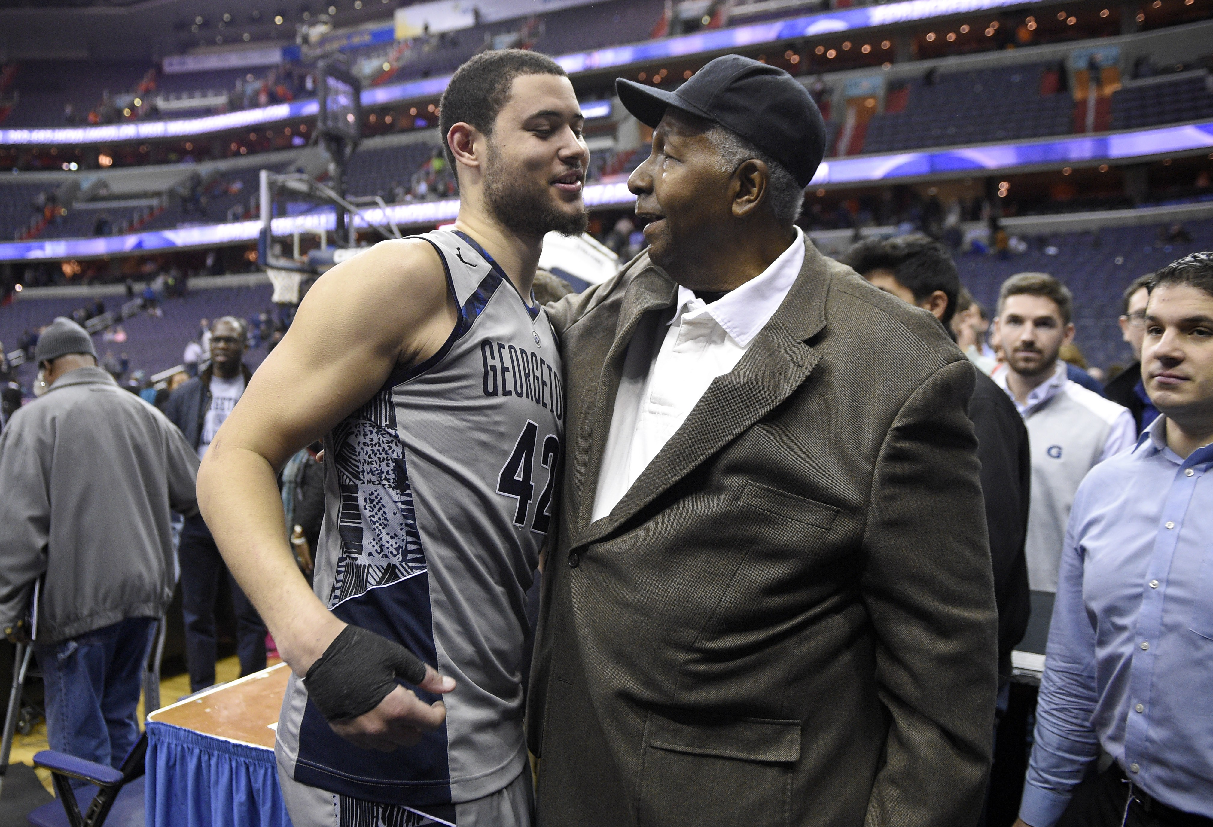 Georgetown center Bradley Hayes (42) is greeted by John Thompson Jr., right, father of Georgetown head coach John Thompson III, after an NCAA college basketball game against Syracuse, Saturday, Dec. 5, 2015, in Washington. Georgetown won 79-72. (AP Photo/Nick Wass)