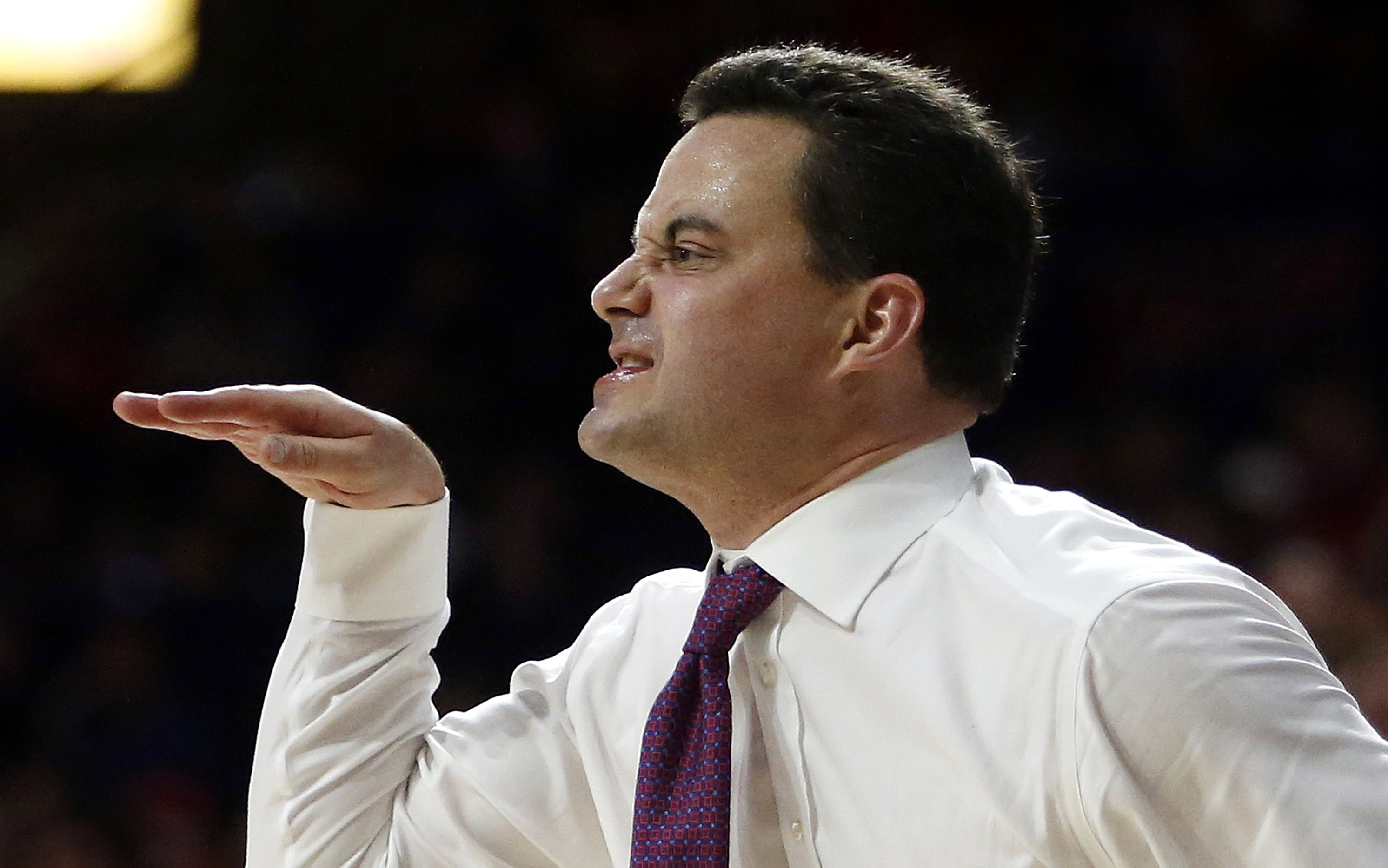 Arizona coach Sean Miller reacts to a foul call during the first half of Arizona's NCAA college basketball game against UCLA, Friday, Feb 12, 2016, in Tucson, Ariz. (AP Photo/Rick Scuteri)