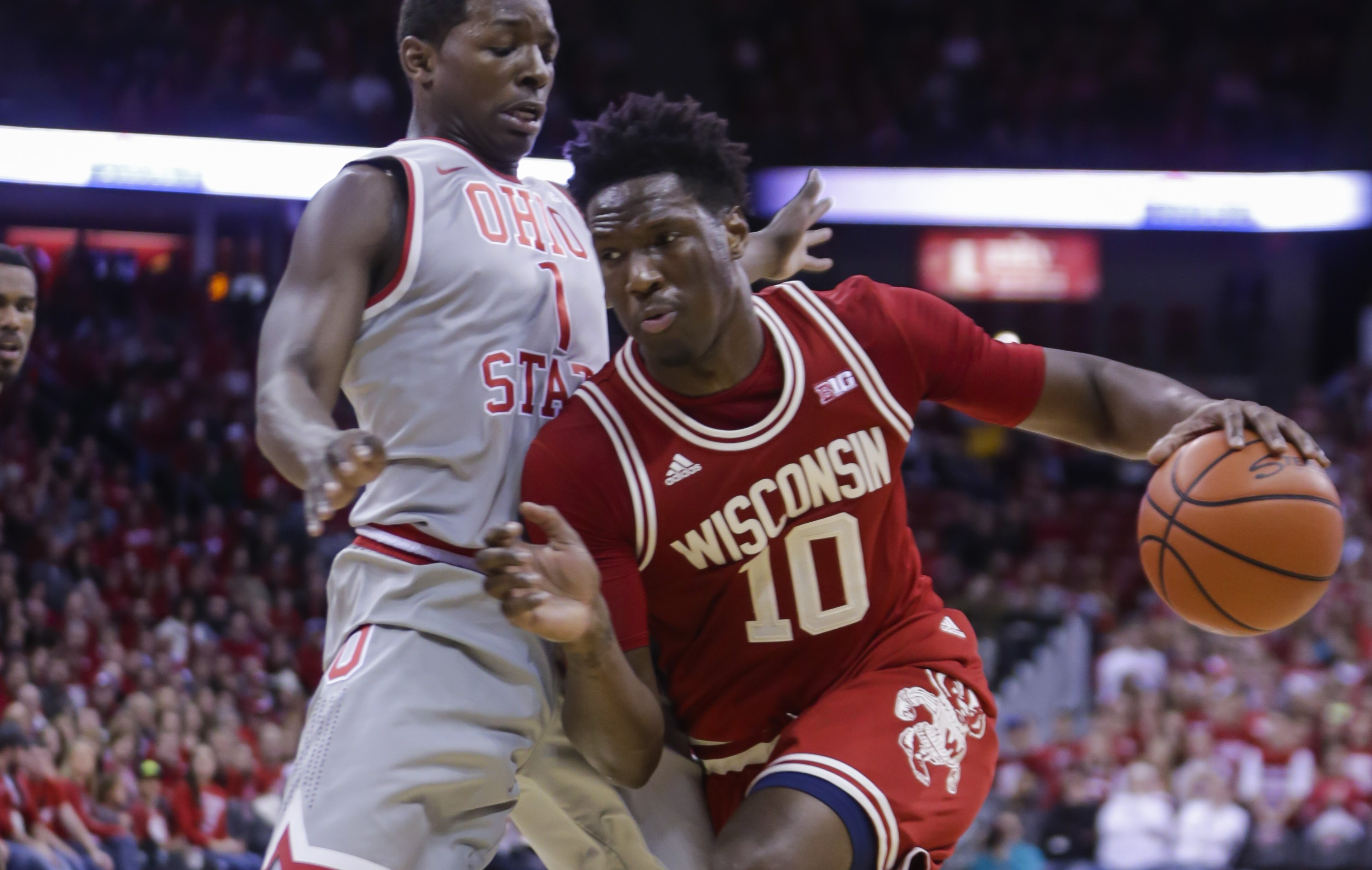 Wisconsin's Nigel Hayes (10) drives on Ohio State's Jae'Sean Tate (1) during the second half of an NCAA college basketball game Thursday, Feb. 4, 2016, in Madison, Wis. Hayes had a team-high 21 points in Wisconsin's 79-68 win. (AP Photo/Andy Manis)