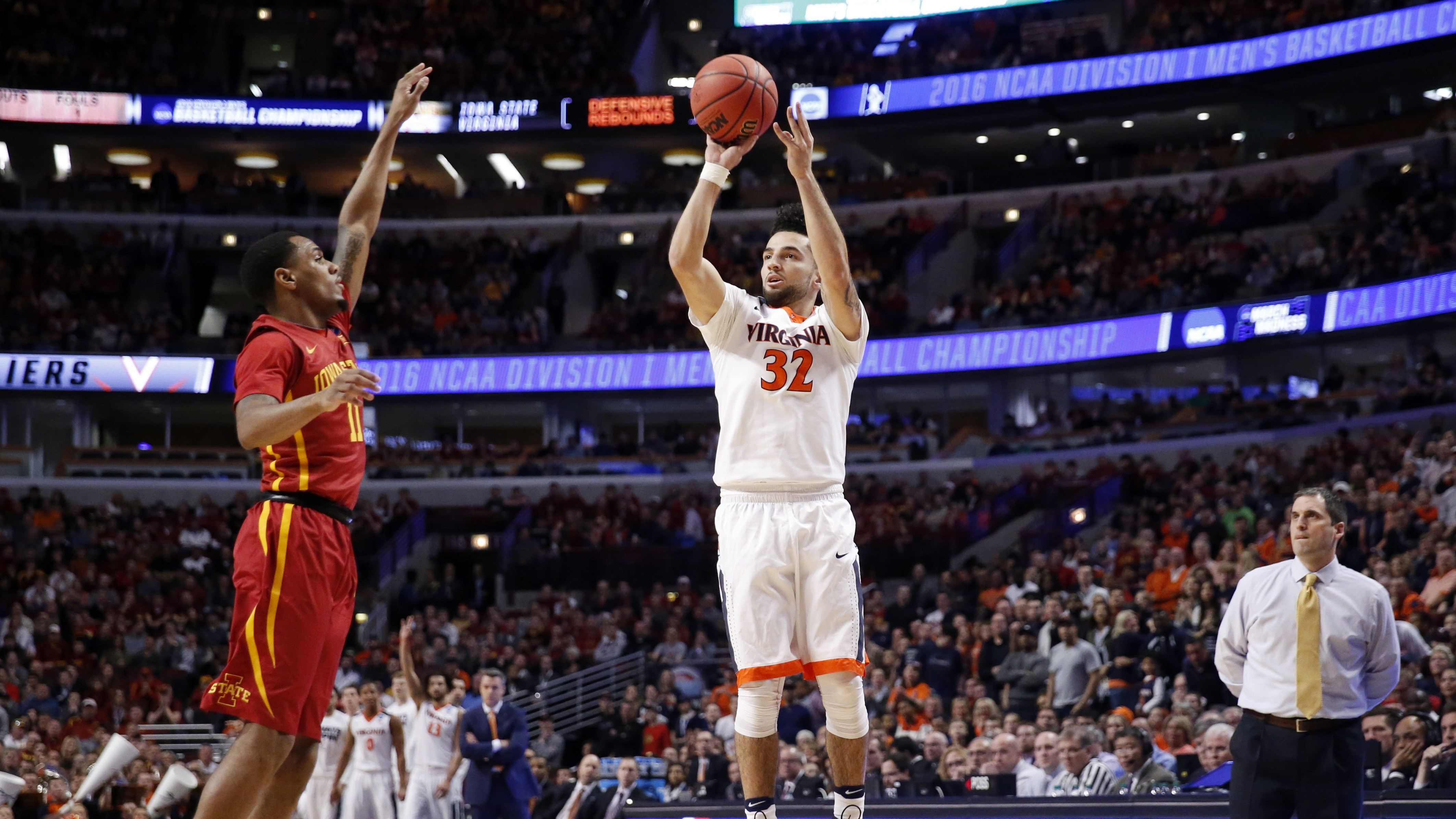 Virginia's London Perrantes (32) shoots against Iowa State's Monte Morris (11) during the first half of a college basketball game in the regional semifinals of the NCAA Tournament, Friday, March 25, 2016, in Chicago. (AP Photo/Charles Rex Arbogast)